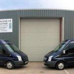 R A Commercials building and vans